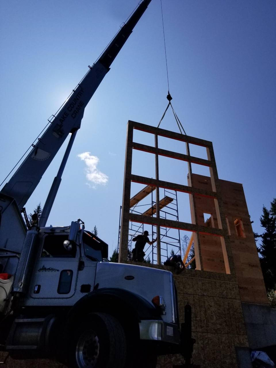 wall being installed with the help of a crane