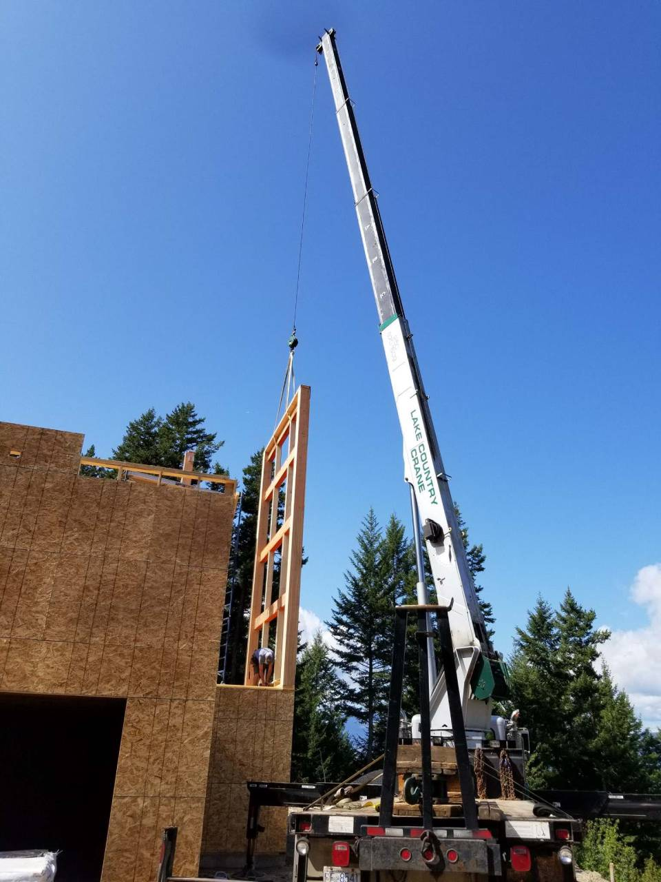 crane being used to install a wall